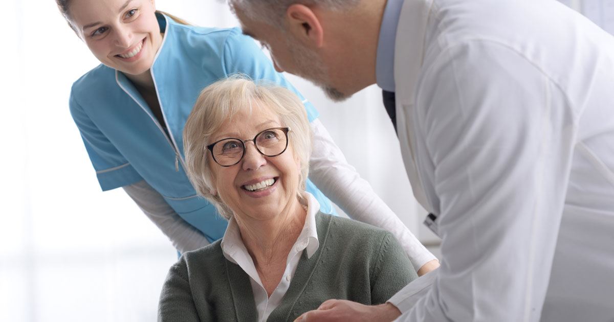 Elderly Woman Shaking Doctor's Hand