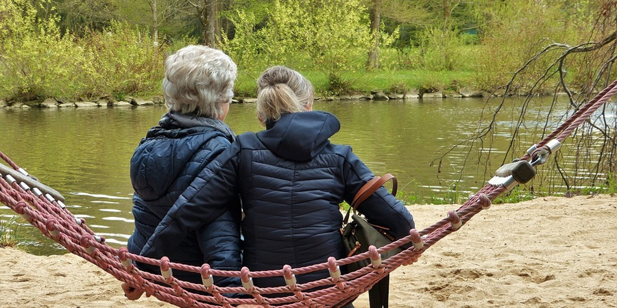 Daughter & Mother with Dementia Sitting by the Pond